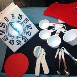 Kitchen items adapted for low vision or blindness, includes large print timer, measuring cups and si