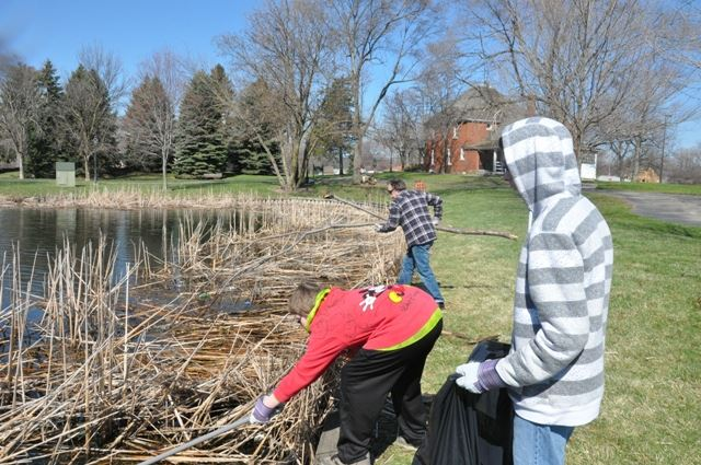 Cleaning up around the lake.