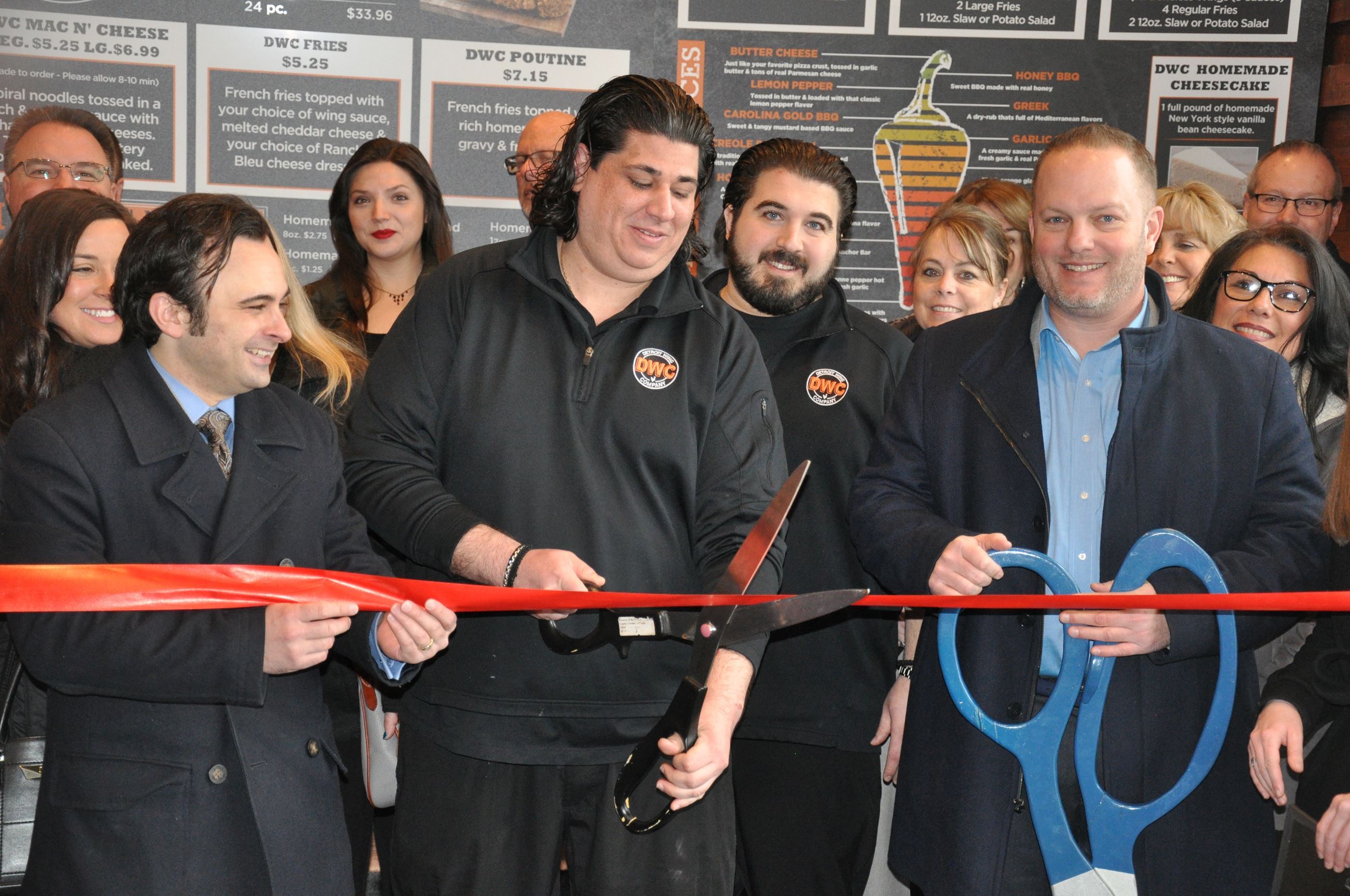 Cutting the opening ribbon at Detroit Wing