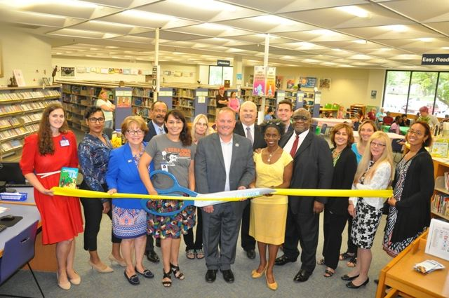 ribbon cutting for early literacy stations